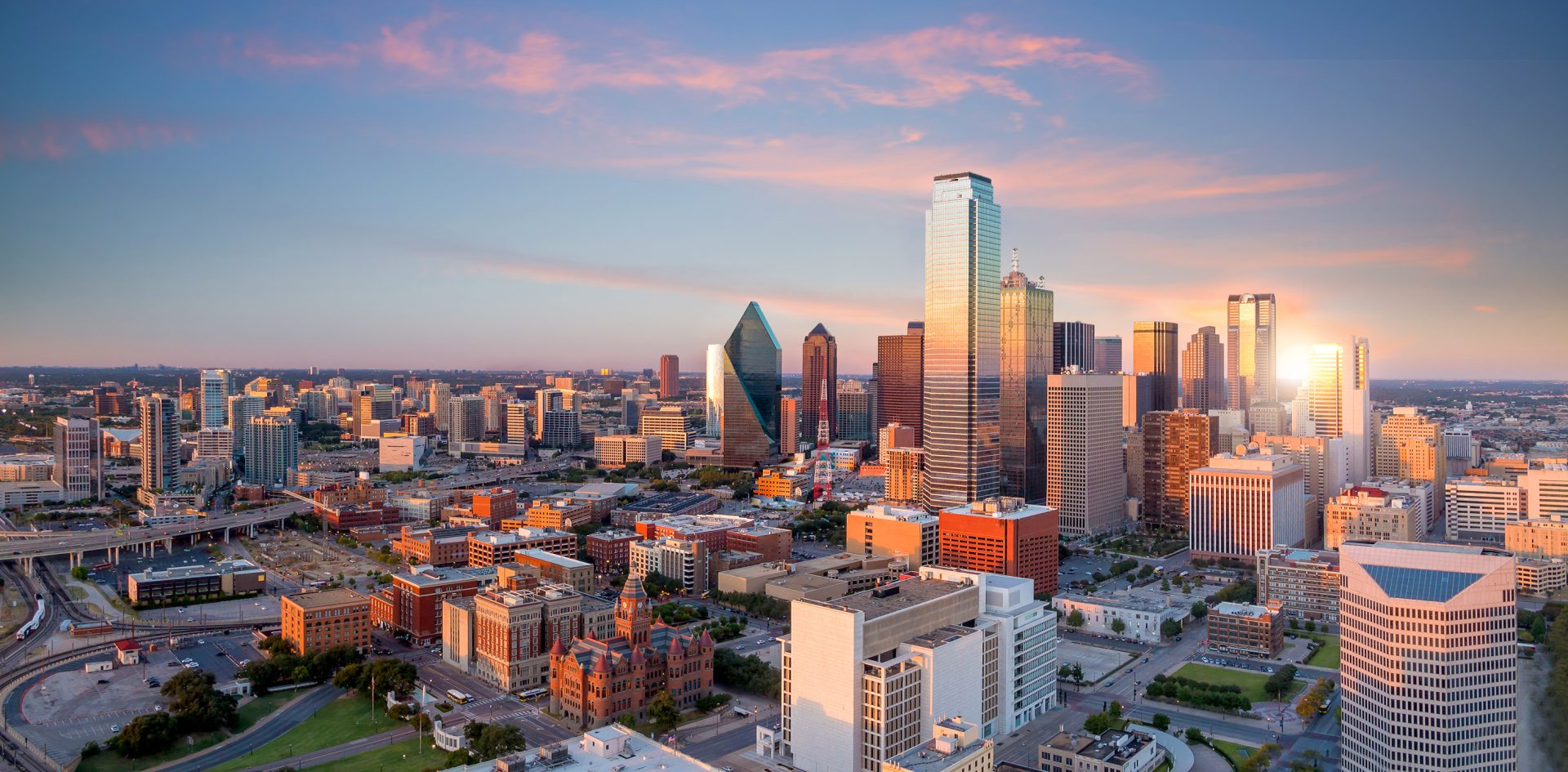 Dallas,,Texas,Cityscape,With,Blue,Sky,At,Sunset,,Texas